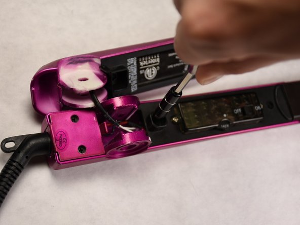Using a Philips head #1 screwdriver remove the two 6mm black screws on both sides of the dial panel cover.