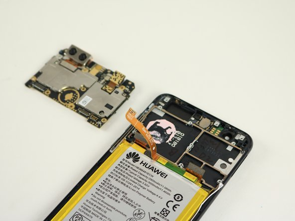 Lift the motherboard to remove it from the body of the phone.