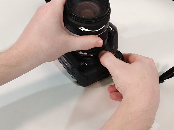 Fit lens into place and turn clockwise to secure it back to camera.