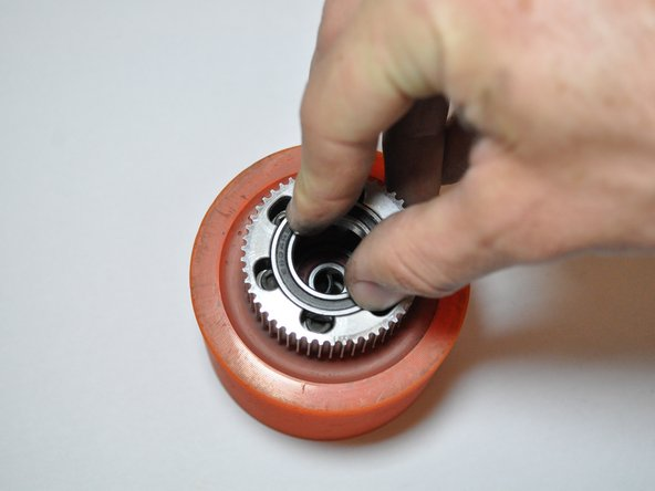 The bearing should be flush with the gear