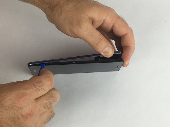 Remove the plastic frame on the device using a plastic prying tool.