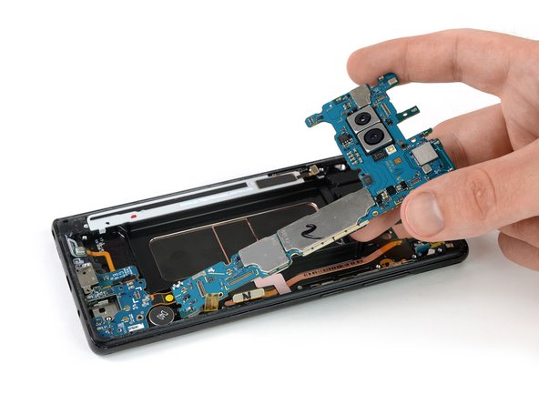 Carefully lift up the motherboard.