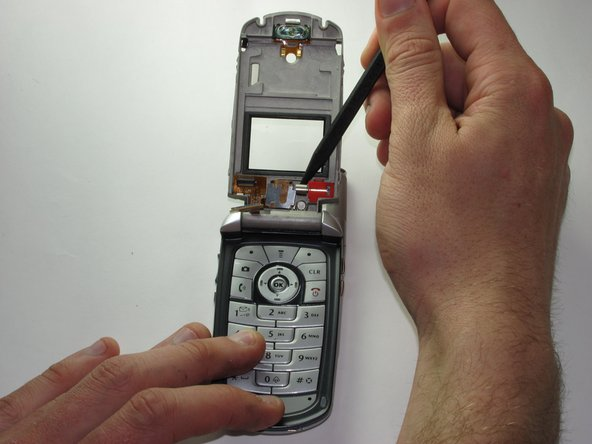 Remove the vibrating motor from the phone with the spudger.
