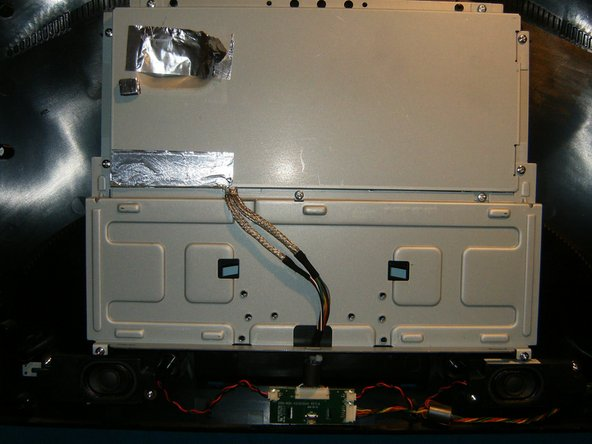 Image 3/3: With the cables removed, just lift the panel up and away. The chassis and metal case for the electronic is next