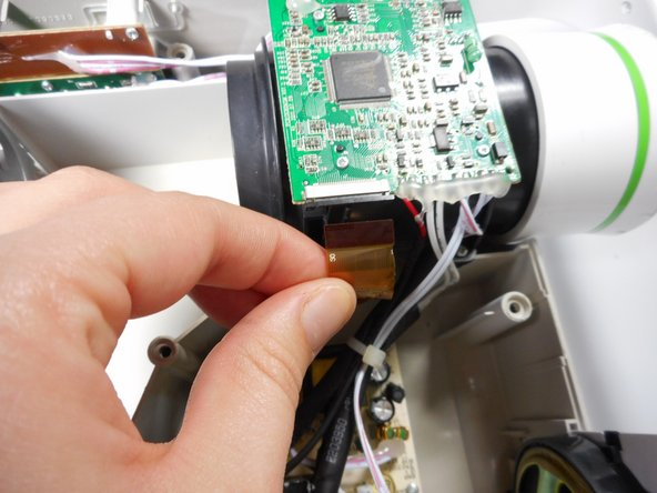 Once the ribbon cable is disengaged gently pull the cable off the motherboard.