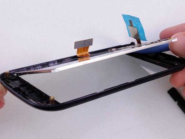 Adhesive material around edge of LCD.