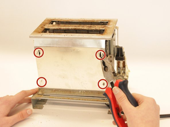 To disassemble the core of the toaster, use pliers to twist the 4 metal clips that stick out on each side of the core (so, 8 in total).