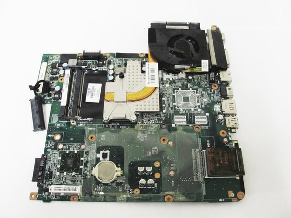Flip over the motherboard to expose the fan assembly.