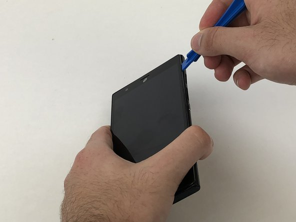 Use an plastic opening tool or your hands to peel the back off the device.