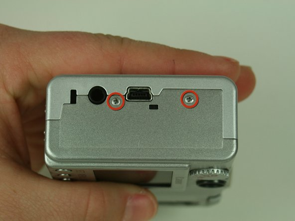 Remove the two screws located on the right side of the camera.(the side with the USB adaption plug)
