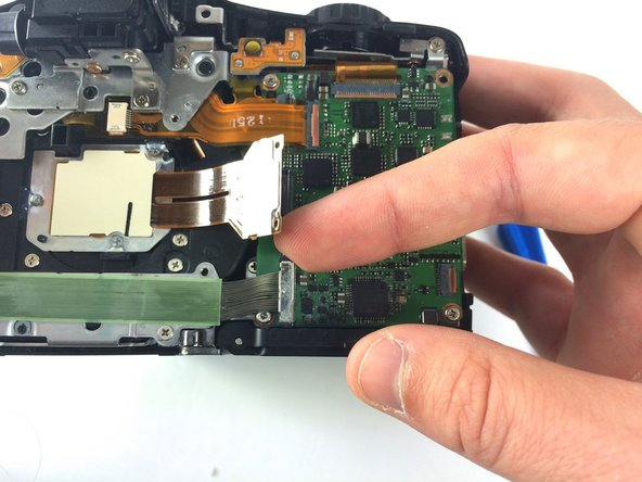 Remove the two wire ribbons on the bottom left corner of the I/O board by unclipping them with your fingers.