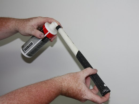 Pour grip solvent into the grip, approximately 1/3 full, while holding one finger on the end of the grip to avoid it running out.