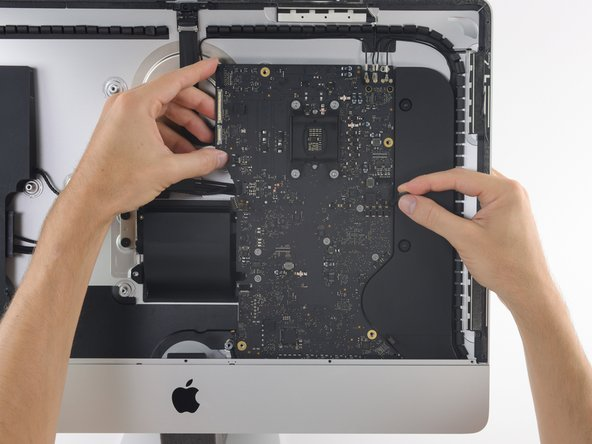 Image 1/3: As you tilt the logic board, pull the right speaker connector to the right and out of the way of the board.