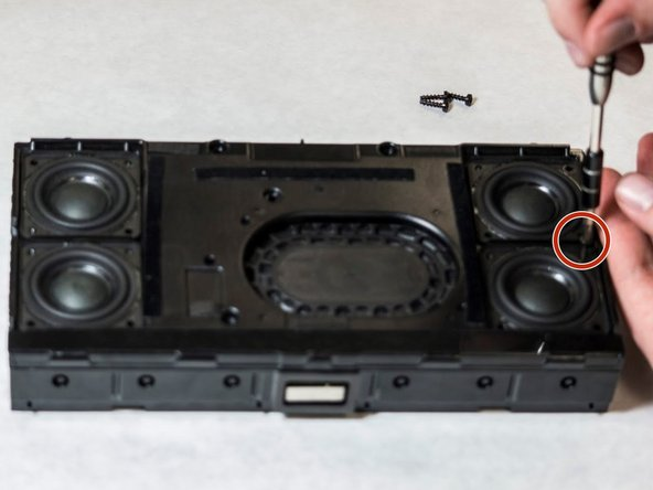 Using the T-10 star tip screwdriver, unscrew the four 13 mm screws around each of the speakers.