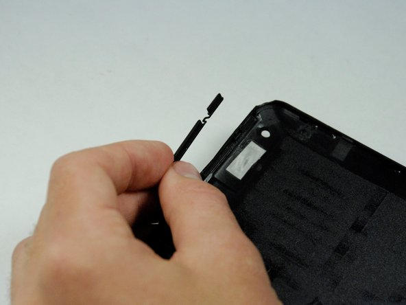 The plastic volume button cover may fall out when you remove the back panel.    Set it aside.
