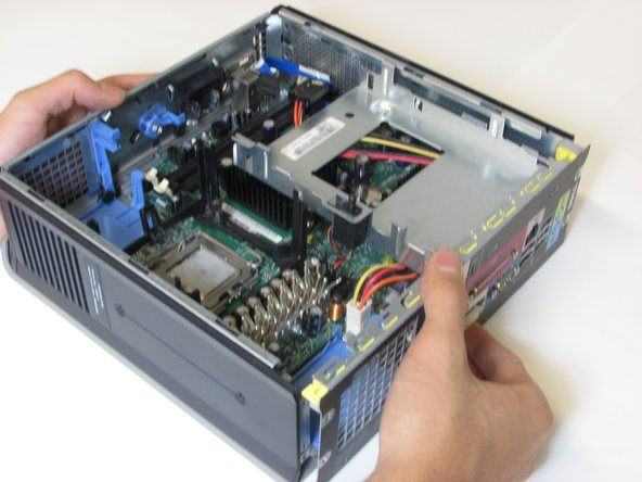 Carefully detach the motherboard from the computer case.