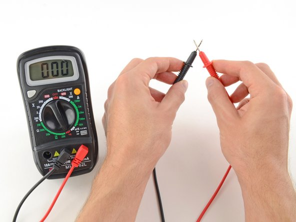 Image 1/2: If the probes are connected—either by a continuous circuit, or by touching each other directly—the test current flows through. The screen displays a value of zero (or near zero), and the multimeter '''beeps'''. Continuity!