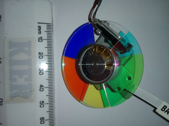 To remove the colour wheel you will need to cut a cable tie and move the wires to the side.