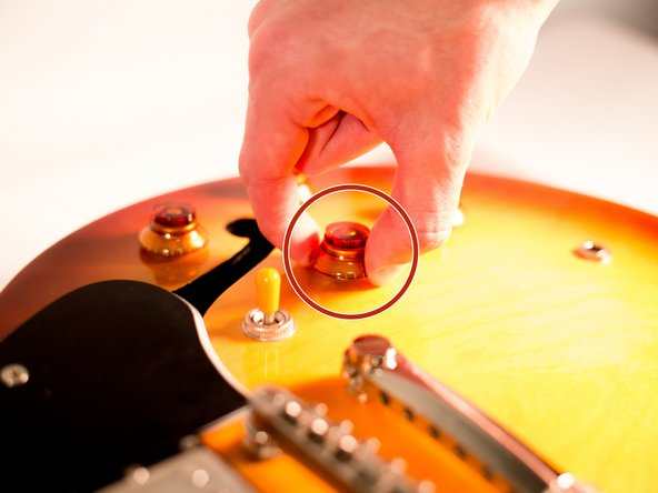 Locate on the guitar's body the volume knob you wish to replace.