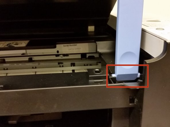 Lower the scanning unit until the scanning unit support seats in the scanning unit support slot.