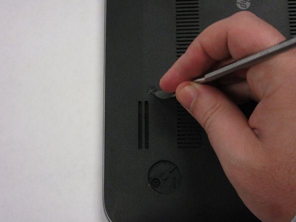 Remove plastic cover highlighted.  It should expose a screw that you will need in a later step.