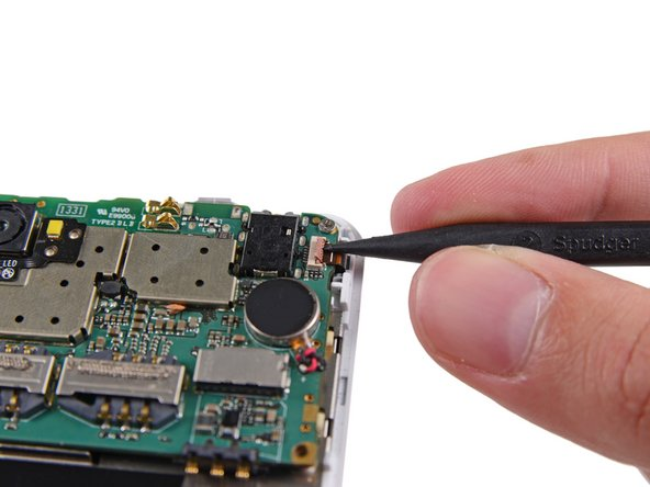 Use tweezers to pull the digitizer cable away from its socket on the motherboard.