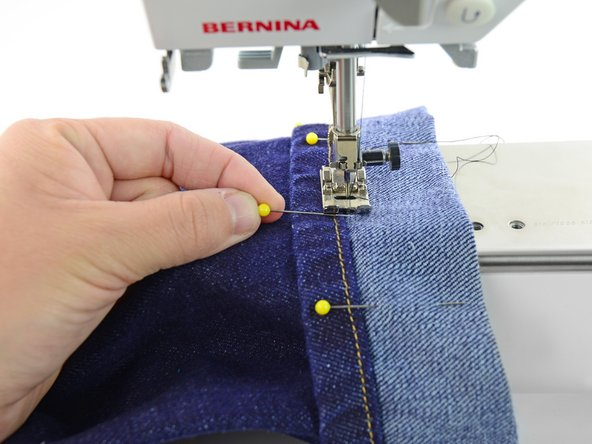 Image 2/3: Never sew over pins. If the needle of the sewing machine hits a pin it can bend or break.