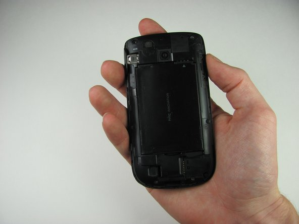 First remove the back cover of your phone to expose the battery.