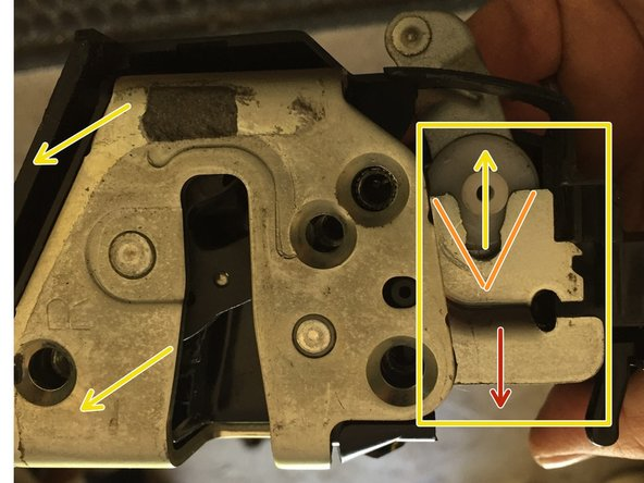 "I this step we have to apply quite a bit of force to separate/release the latch mechanism containing the metal plate.  The first photo shows white plastic part that is held tightly in the metal ""V"" notch has been released after pressing downward on the metal ""shelf"""
