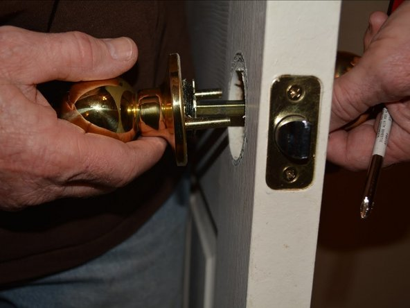 Remove the door knob on both sides of the door.
