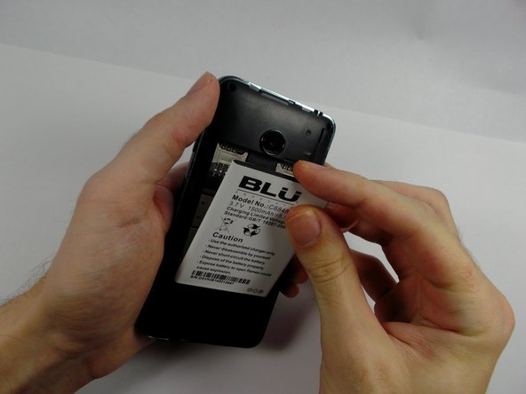 Place new battery with the correct orientation in place of the old one.