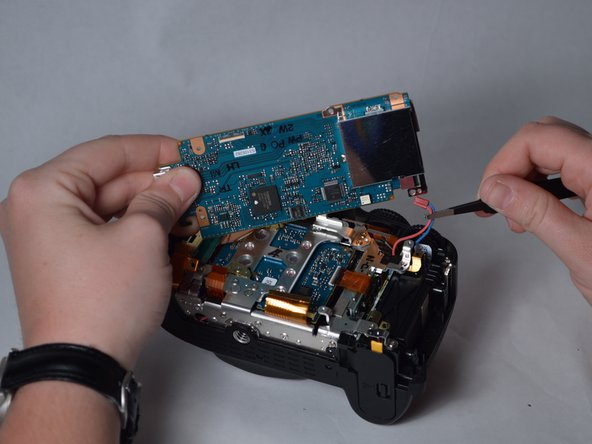 Image 3/3: Unplug the red and blue wires from their socket.