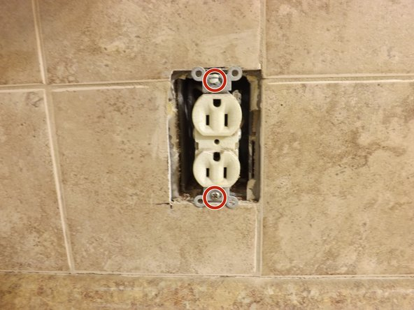 Remove plate from outlet using a Phillips screwdriver.