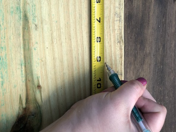 Mark your measurements on both ends of your new weather treated wood using a measuring tape and a pencil.