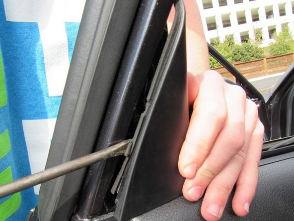 Use flathead to pry off the upper panel located at the top of the rear door panel.