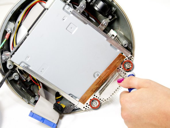 Using a Torx #9 screw driver, remove the two 8.77mm screws holding the drive's shield onto your iMac G4.