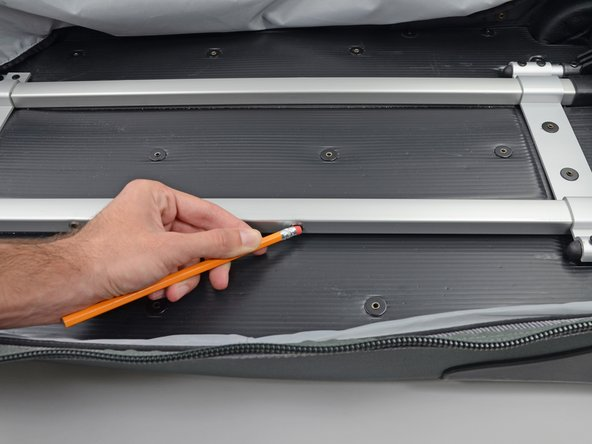 Image 3/3: If either pin is not retracting use a pencil, screwdriver, or other thin object to push the pin into the hole.