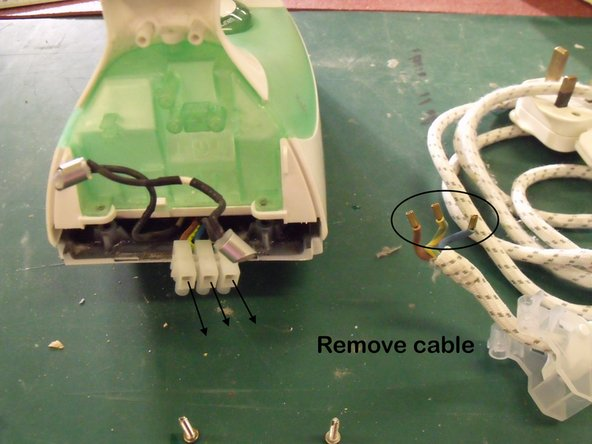 To free the long cable remove from terminal block at rear.