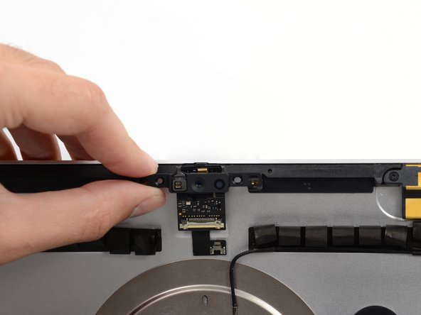 Lift and remove the camera assembly from the iMac.