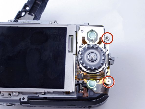 "Remove two 3.2mm PH000 screws on the side of the camera, to the right of the button that reads ""Func. Set."""