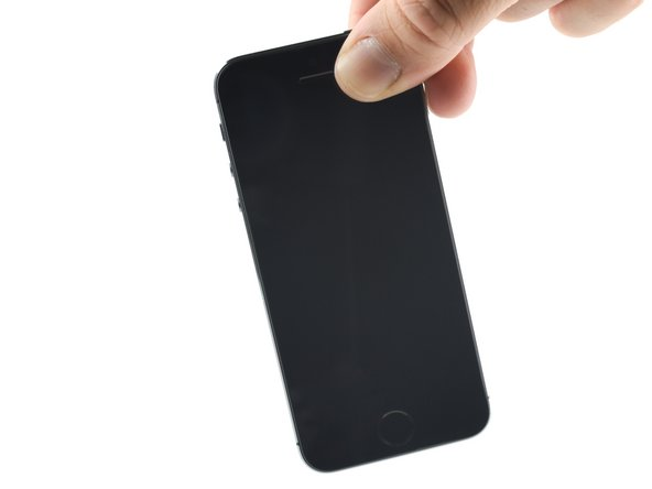 Image 2/2: Use a cloth to dry any liquid on the outside of the phone.