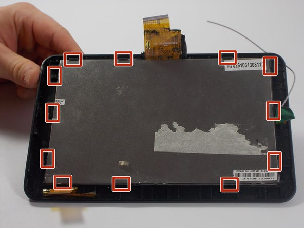 The back of the digitizer is attached along the edge by 12 plastic clips.