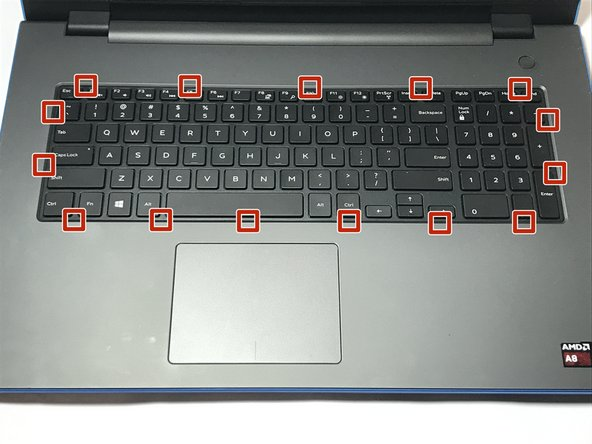 Open the display of the laptop as far as possible, and locate the tabs which secure the keyboard to the laptop.