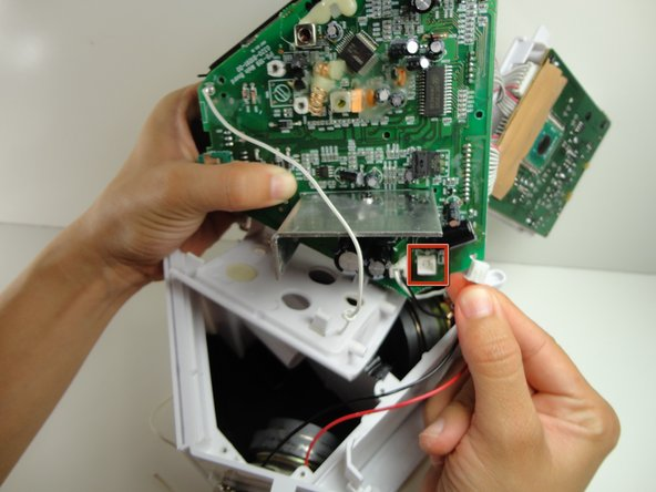 Pull out the white plug that goes from the speakers to the logic board.