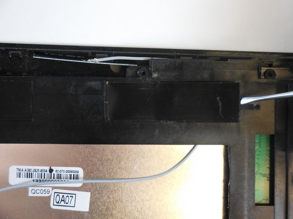 Turn the black internal mounting piece over to access the back of the speaker.