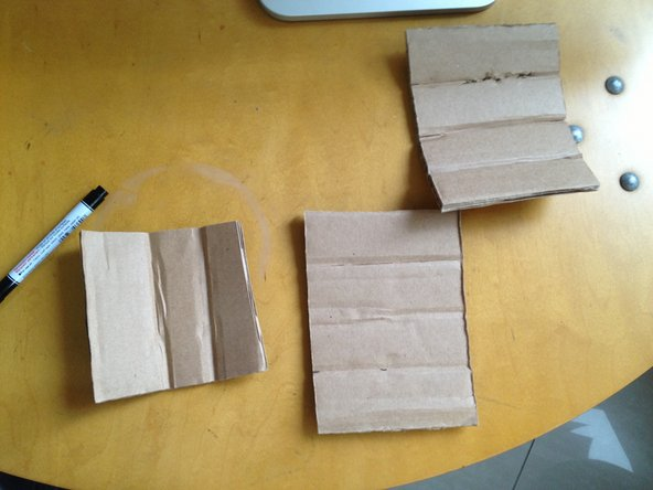Cut up a rectangle and fold to make up a cylinder. Use scotch tape to hold them together.