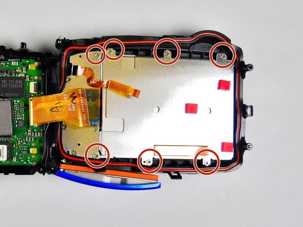Image 1/3: Remove the remaining five 3.0 mm screws which hold the rear case and the control panel together.