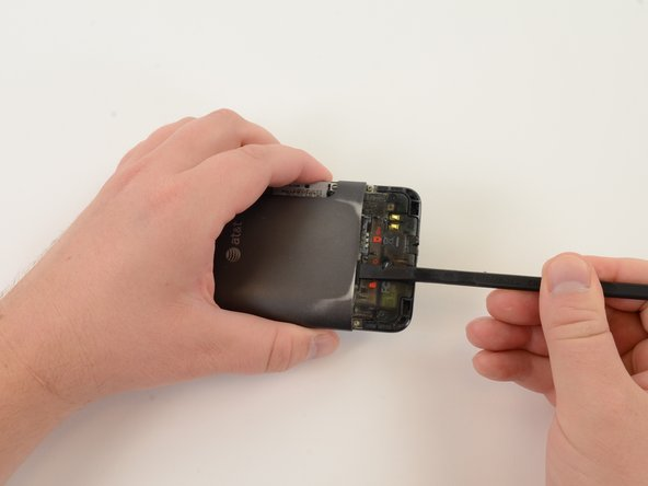 Remove Micro SD card by pushing it in to the phone. Spring-loaded clasp will release the card.