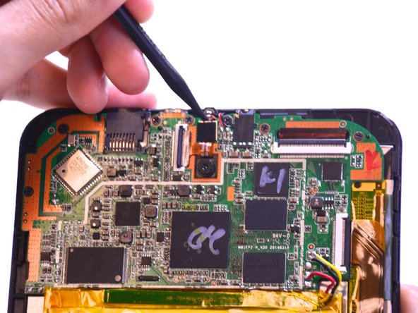 Using the pointed end of the spudger, remove the front and back camera by lifting the camera out of the mother board.