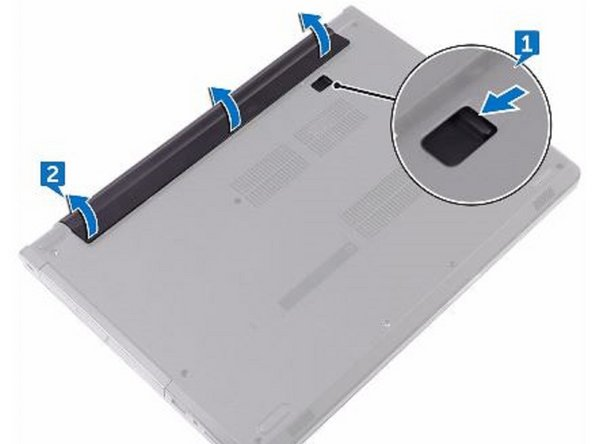 Slide the tabs on the NEW battery into the slots on the battery bay and snap the battery into place.